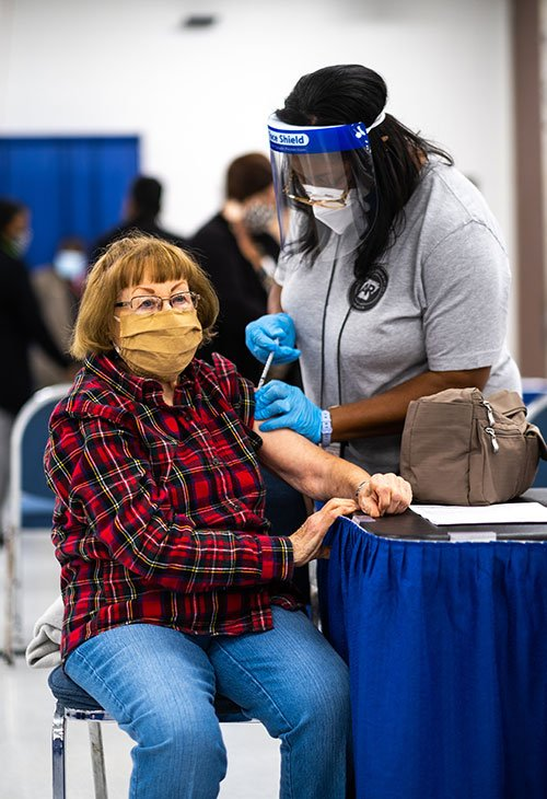 Woman recieving a COVID-19 vaccine
