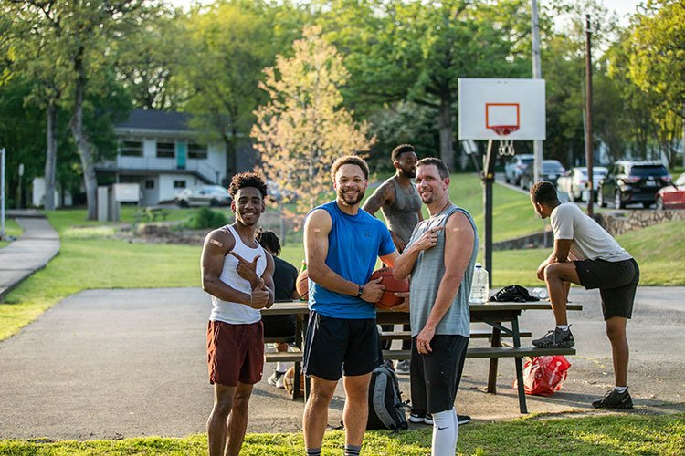 http://Group%20of%20men%20at%20a%20basketball%20court%20pointing%20to%20where%20they%20got%20their%20COVID-19%20shot