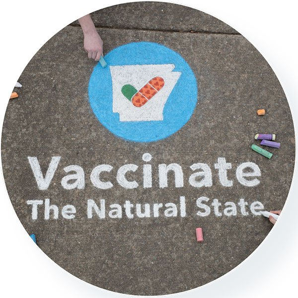 Drawing of the Vaccinate the Natural State logo on a street